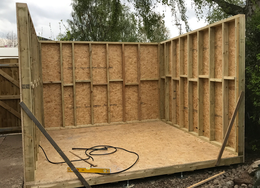 Three of the garden room walls are up