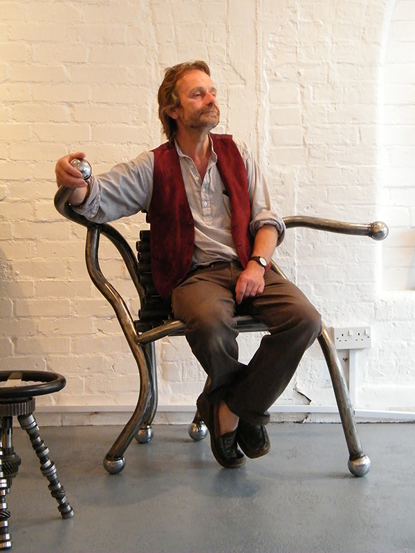 Artist Neil Warmsley tries out the Boule Chair