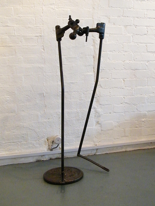 Body Sculpture - metal sculpture constructed from found objects - a plough, car parts and a weight