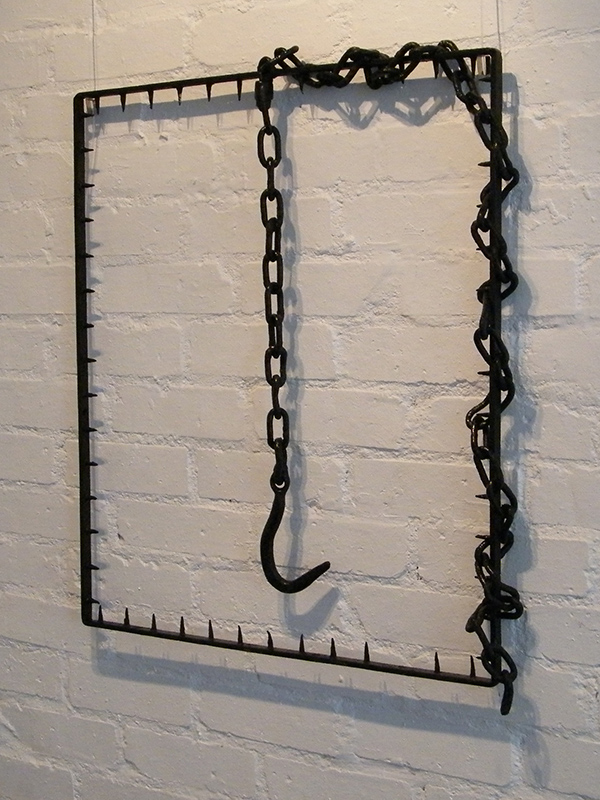 Hooked - Metal wall sculpture created from found objects