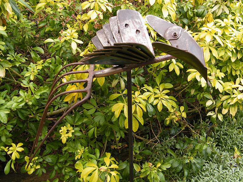 The Ridger - Metal bird sculpture created from farming implements